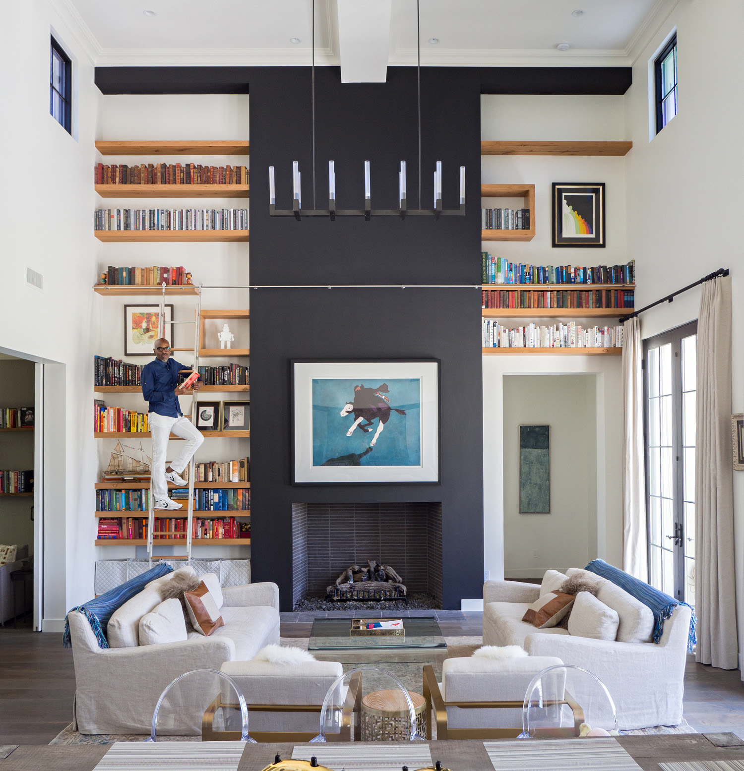 custom built in bookshelves with stainless steel rolling ladder paul rene furniture and cabinetry