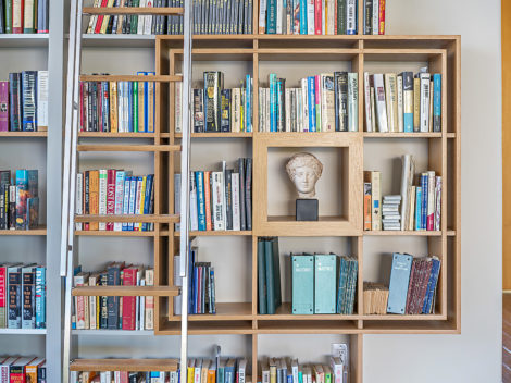 contemporary painted library mixed with wood with stainless steel ladder by paul rene furniture and cabinetry phoenix az