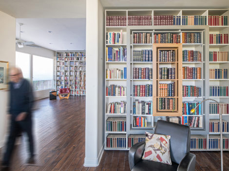 custom contemporary library with stainless steel rolling ladder by paul rene phoenix az