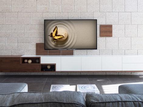 Custom designed modern entertainment center by paul rene furniture